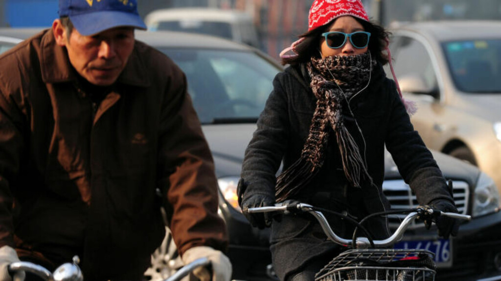 KINA: Står sammen med USA for halvparten av verdens klimagassutslipp. Foto: AFP PHOTO/Frederic J. BROWN/ SCANPIX.