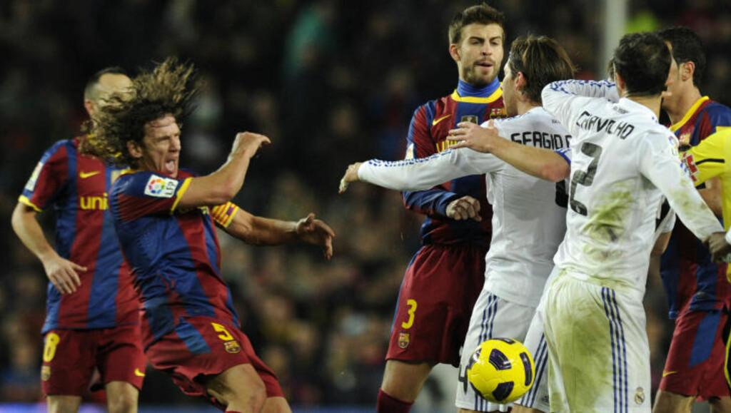 OVERSPILTE: Selv om Carles Puyol nok overspilte litt, er det liten tvil om at Sergio Ramos mistet hodet. Foto: JAVIER SORIANO/AFP