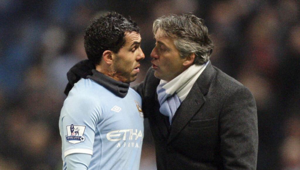 IKKE DIN SKYLD: Carlos Tevez avviser at det er en rift mellom ham og Roberto Mancini. Mellom ham og andre medlemmer av ledelsen i Manchester City er det åpenbart flere.Foto: SCANPIX/AP/Jon Super