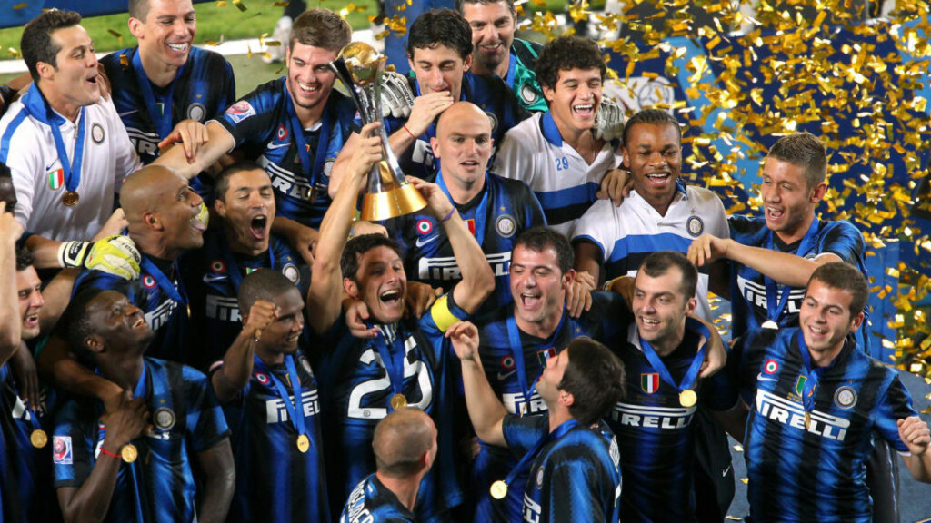 Inter Milan's players celebrate with the trophy after winning the 2010 FIFA Club World Cup at Zayed Sports City in the Emirati capital Abu Dhabi on December 18, 2010. European champions Inter Milan won 3-0 over African champions TP Mazembe of the Democratic Republic of Congo. AFP PHOTO/MARWAN NAAMANI