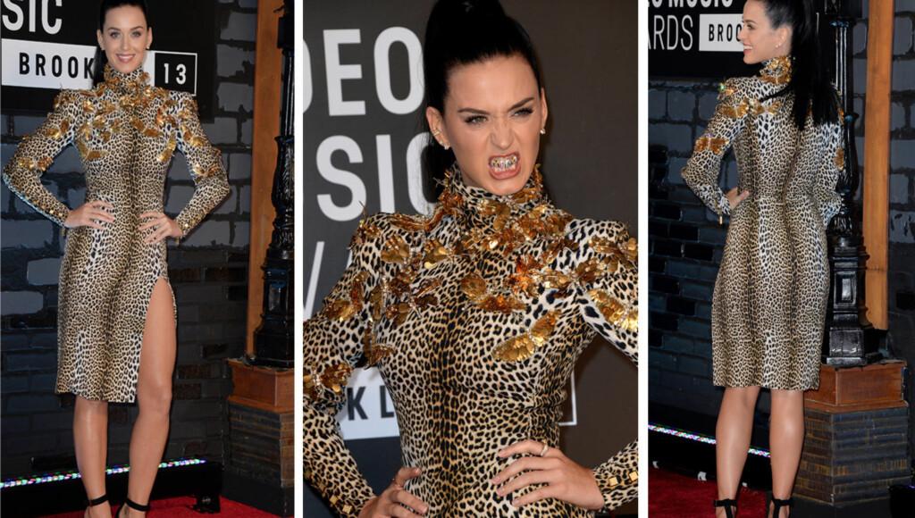 JUNGELENS DRONNING: Katy Perry så ut som hun kom rett fra safari i sin leopardkjole fra Emanuel Ungaro. Spesiallagde grillz sikret henne en plass på listen over kveldens verst kledde.