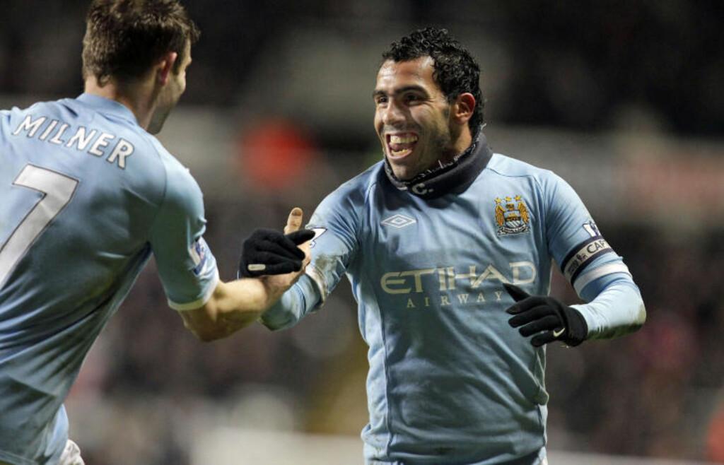 SMILER IGJEN: Smilet var tilbake hos Carlos Tevez mot Newcastle da han scoret to og la opp til ett i en sterk seier på St. James Park.Foto: SCANPIX/AFP PHOTO/GRAHAM STUART