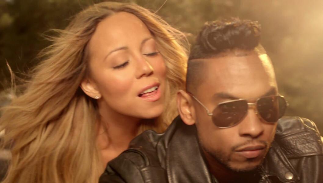 <strong>SAMARBEID:</strong> Miguel har blant annet jobbet sammen med popstjernen Mariah Carey på låten «Beautiful». Her er duoen i et klipp fra den sexy musikkvideoen. Foto: FAME FLYNET