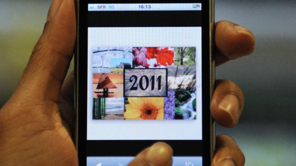 NYTTÅRSTRØBBEL FOR IPHONE: Vekkefunksjonen på både Iphone 3GS og Iphone 4 fungerte ikke for mange brukere i dag tidlig. Foto: Scanpix