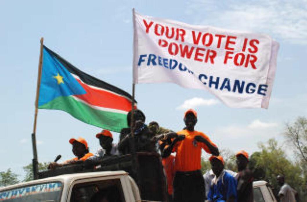 ØNSKER DELING: Sør-Sudanere demonstrerer for en løsrivelse fra Nord-Sudanese i Sør-Sudans hovedstad Juba idag. Foto Peter Martell/AFP/Scanpix