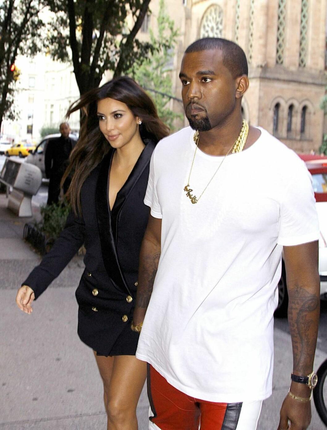 BLIR FORELDRE: Kanye West og Kim Kardashian blir foreldre for første gang i 2013. Foto: All Over Press