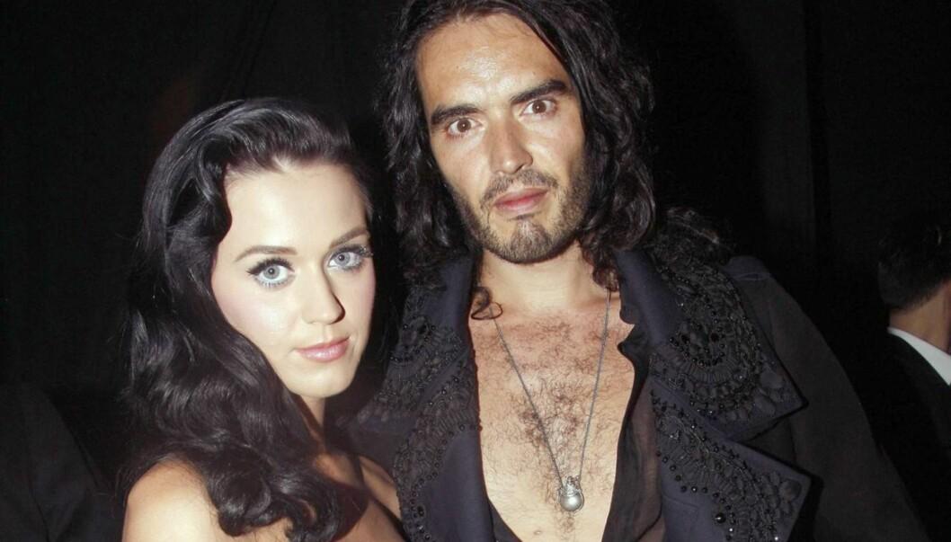 GIKK I DEKNING: Katy Perry skal ha kastet seg under bordet da hun så eksmannen. Foto: All Over Press