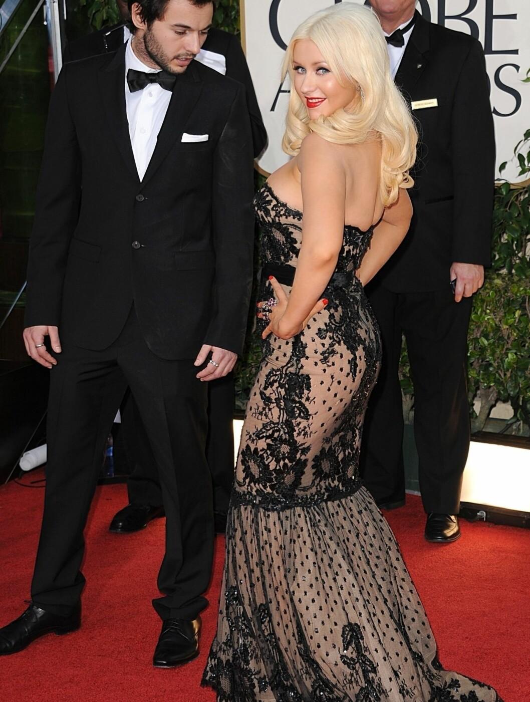 OGSÅ GJENNOMSIKTIG: Aguilera var så tidlig ute som i fjor vinter, med sin gjennomsiktige sorte kjole. Her på Golden Globe Awards i Los Angeles. Foto: Fame Flynet