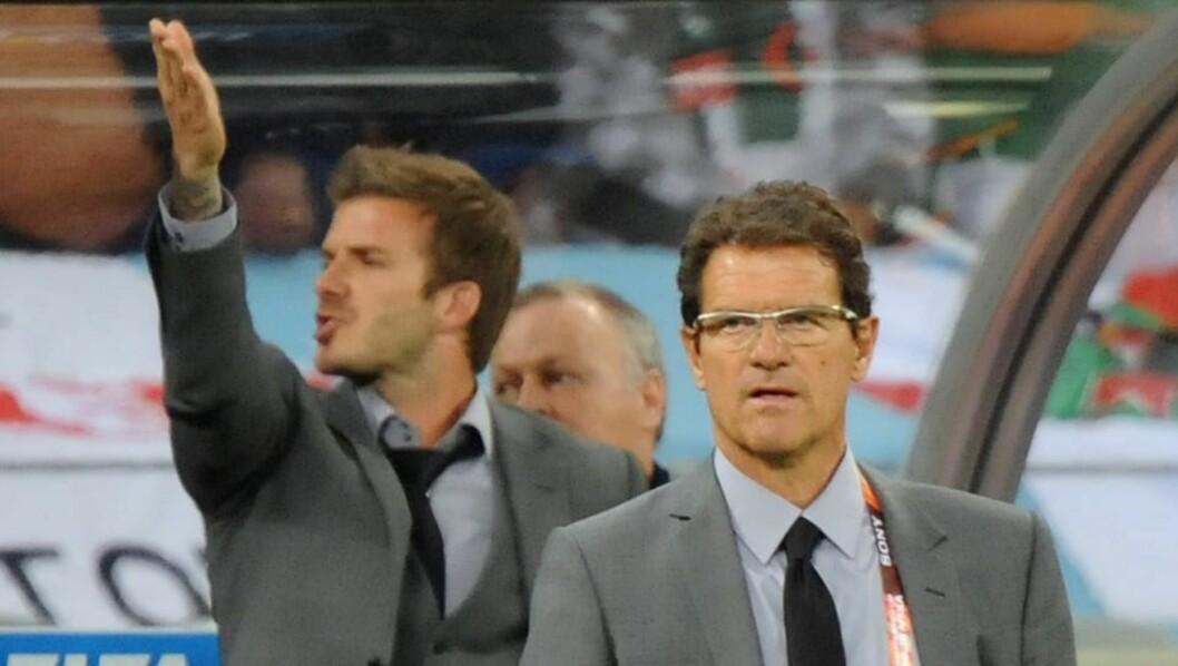 <strong>KONFRONTERT:</strong> Den rasende supporteren skal ha ropt skjellsord mot David Beckham før han til slutt ble geleidet bort av vakter.Foto: SCANPIX/EPA/HELMUT FOHRINGER