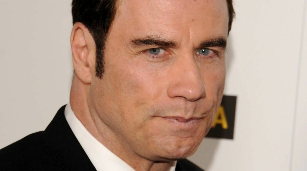 SAKSØKES: John Travolta blir beskyldt for å ha befølt en massør og tilbudt ham penger for sex.  Foto: All Over Press