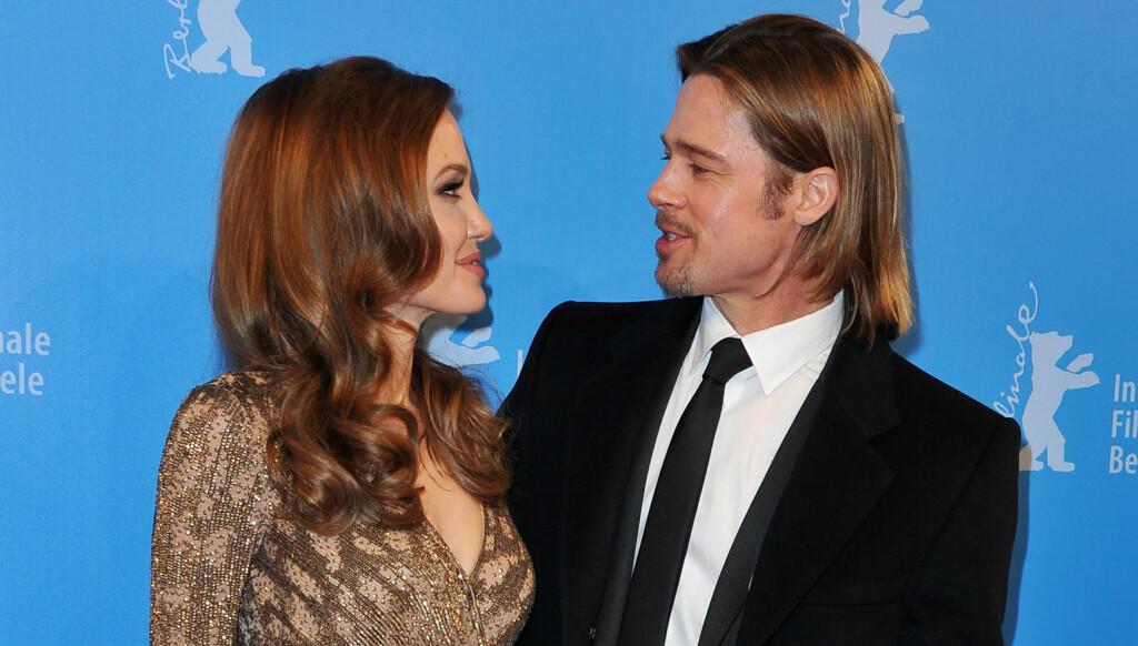 LYKKELIG: Angelina Jolie gråt av glede da kjæresten Brad Pitt gikk ned på kne.  Foto: All Over Press