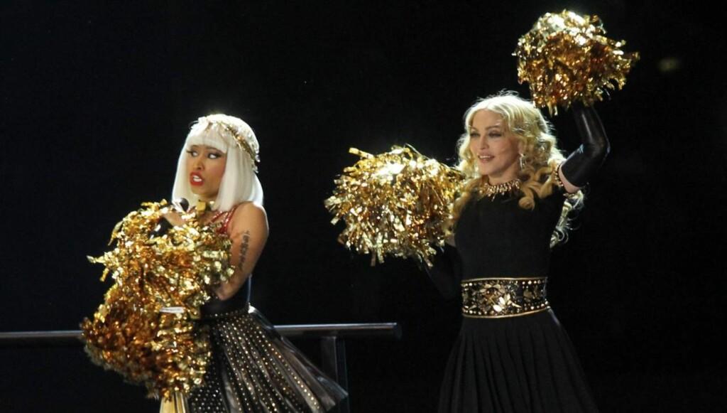 SAMARBEIDER: Madonna samarbeider blant annet med rap-stjernen Nicki Minaj på sin nye plate. Her er de sammen på scenen under årets NFL-finale. Foto: All Over