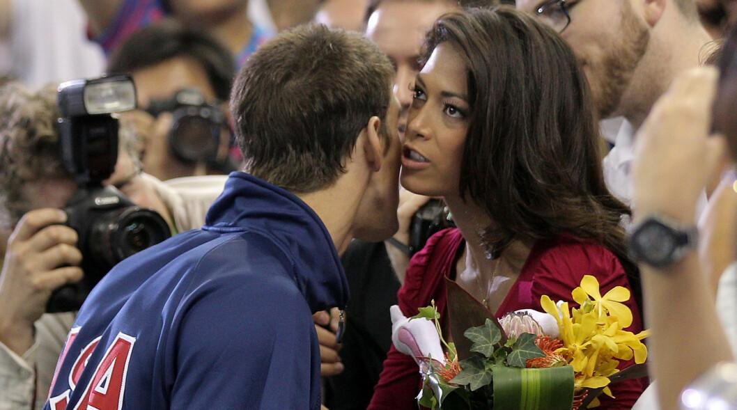 SLUTT: Den amerikanske OL-vinneren i svømming Michael Phelps og kjæresten Nicole Johnson har gått hvert til sitt etter tre år. Foto: All Over Press