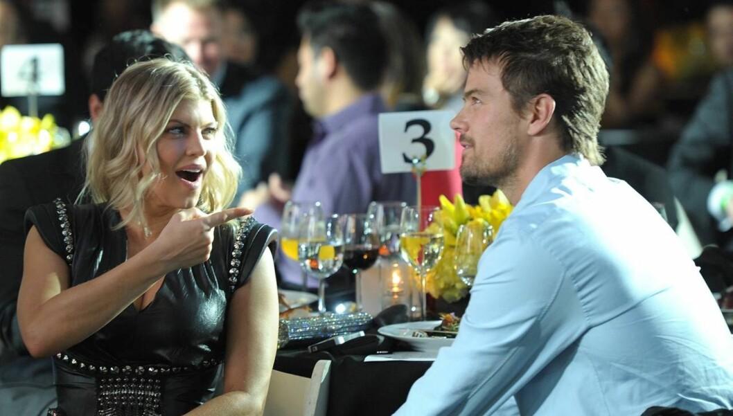 MORO: Fergie har vært gift med sin kjekke, og katolske, ektemann Josh i tre år denne måneden. Nå roer artisten ned band-livet, og ser frem til et nært år med ektemannen.  Foto: All Over Press