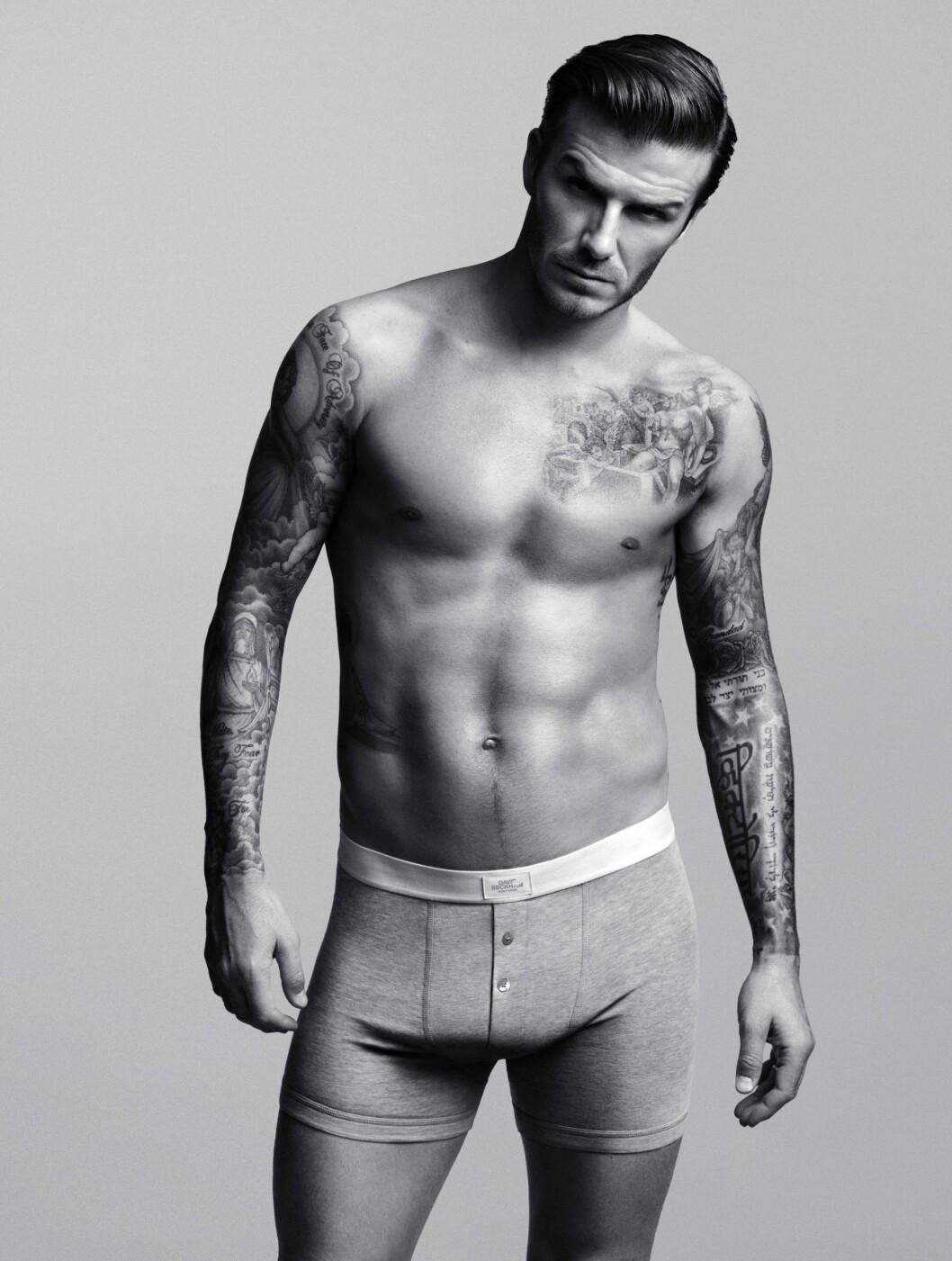 SEXY: Beckham nølte ikke med å kaste klærne og vise frem sin veltrente kropp.  Foto: H&M