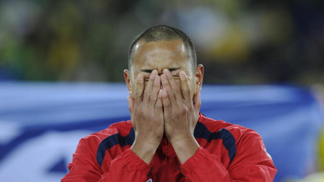 <strong>REFS:</strong> Etter null poeng og 7-0 i sekken mot Portugal ble ikke hjemkomsten til Nord-Korea lystig for spillerne. Foto: AFP