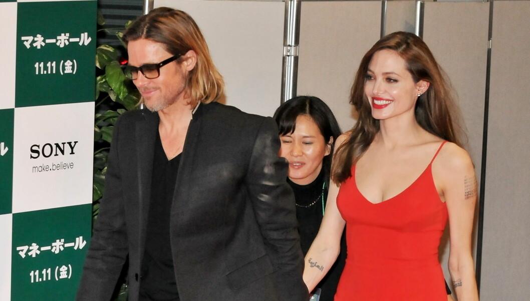 <strong>JAPAN-BESØK:</strong> Brad Pitt og Angelina Jolie på Japan-premieren av Moneyball i Tokyo. Foto: Stella Pictures