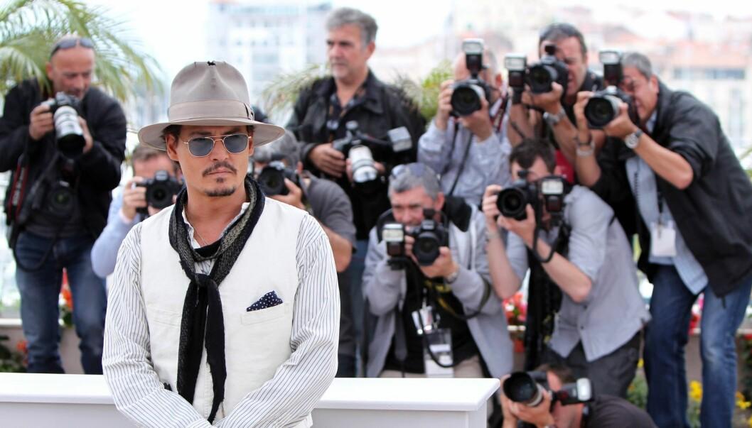 SJOKKERER: Skuespilleren Johnny Depp synes det er så ille å få medieoppmerksomhet at han sammenligner det med å bli voldtatt. Likevel stiller han på Cannes Festivalen, som her. Foto: All Over Press