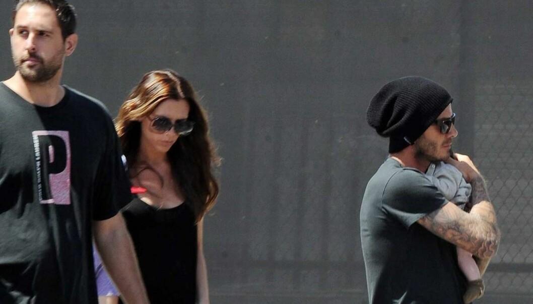 STOLTE FORELDRE: Victoria Beckham og ektemannen David tok med seg lille Harper Seven på shopping i helgen. Foto: All Over Press