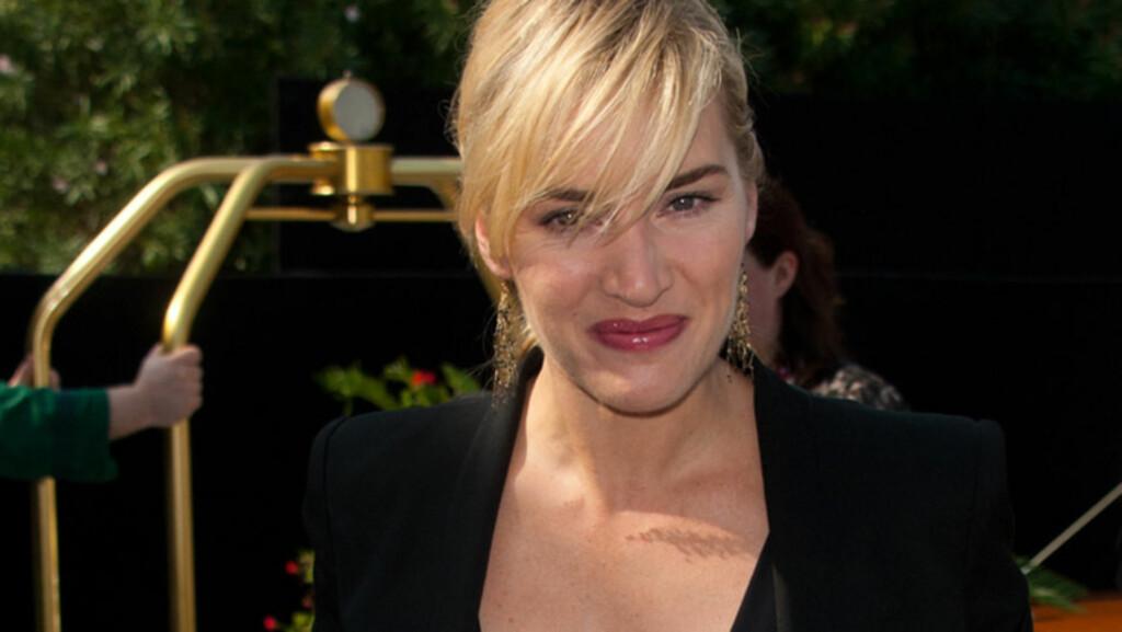 TIL Å SPY AV: Skuespiller Kate Winslet gav barna sine noe å le av da hun tok dem med på filmsettet til «Carnage» - nemlig en proskejtil-spyende mor! Her er skjønnheten avbildet under filmestivalen i Venezia denne uken, der hennes nye film ble vist. Foto: Stella  Pictures