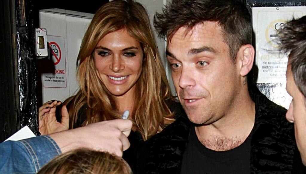 GJORDE GREP: - Jeg vil ikke at faren deres skal være følelsesmessig udugelig - både for min egen del og for barnas, sier Robbie Williams, som her er avbildet med kona Ayda Field. Foto: All Over Press