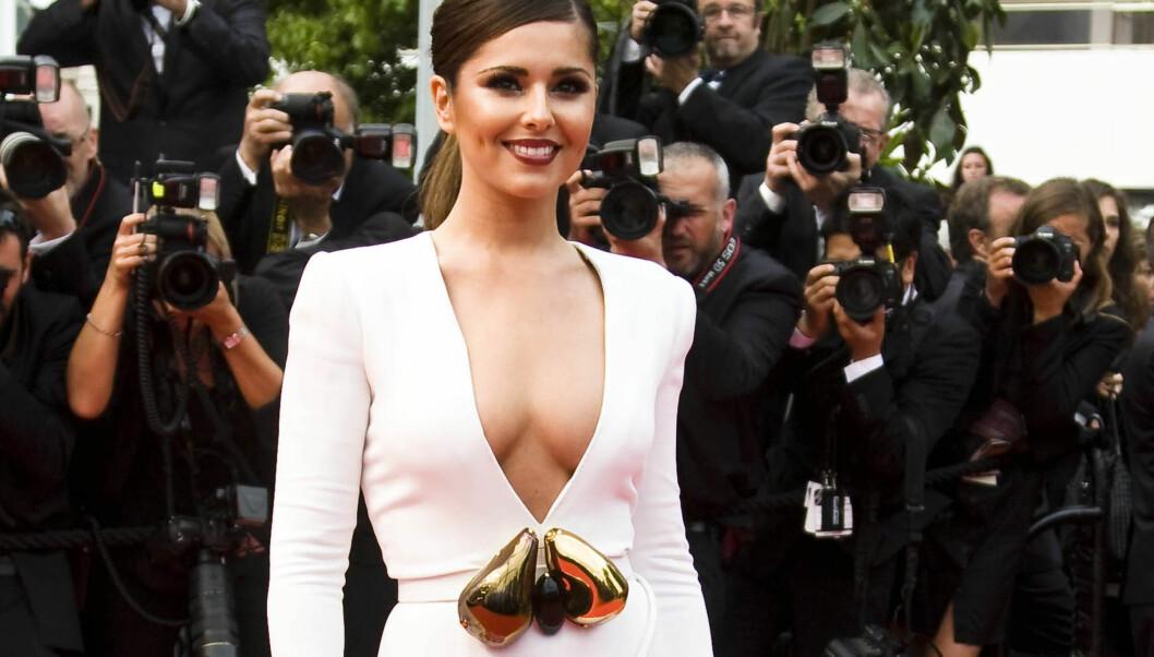 SLÅR TILBAKE: Cole avviser at hun har operert brystene. Foto: All Over Press