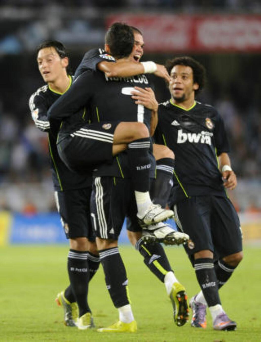 <strong>FIKK ENDELIG BALLEN I MÅL:</strong> I tredje seriekamp mot Real Sociedad fikk Ronaldo omsider ballen i mål - men skuddet gikk via lagkamerat Pepe og i mål. Foto: AFP PHOTO / Ander Gillenea