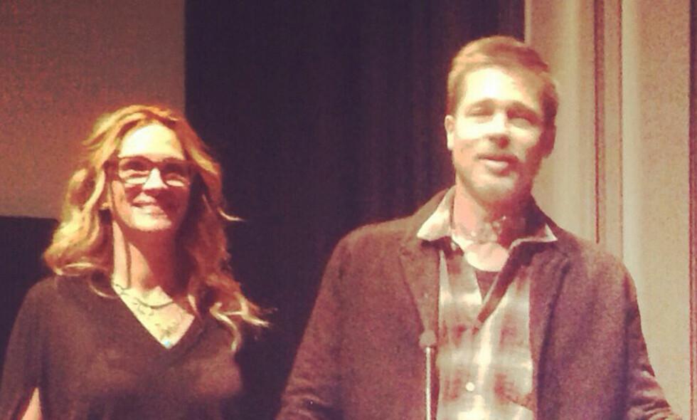 VAR PÅ FILMVISNING: Brad Pitt var på filmvisning sammen med skuespillerkollega Julia Roberts. Dette er første gang han viser seg offentlig etter bruddet med Angelina Jolie. FOTO: Scanpix
