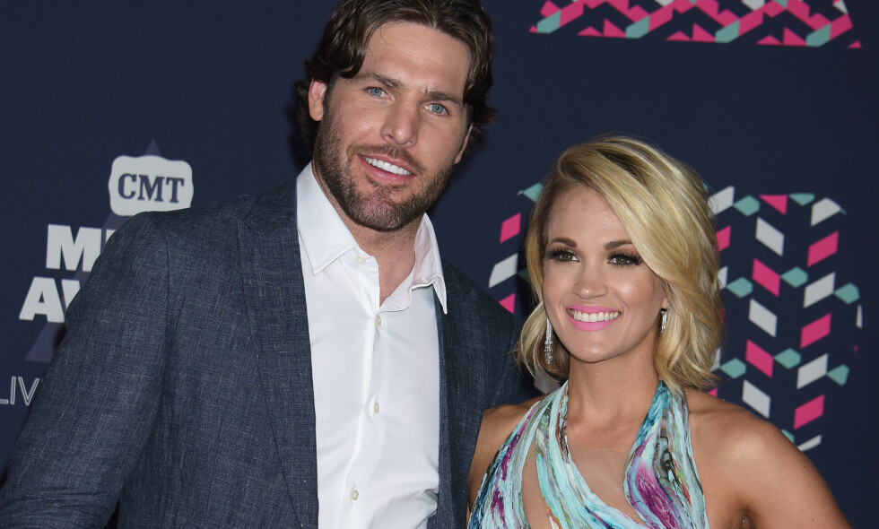 EKTEPAR: Carrie Underwood og ishockeyspiller Mike Fisher giftet seg i 2010. Foto: Pa Photos