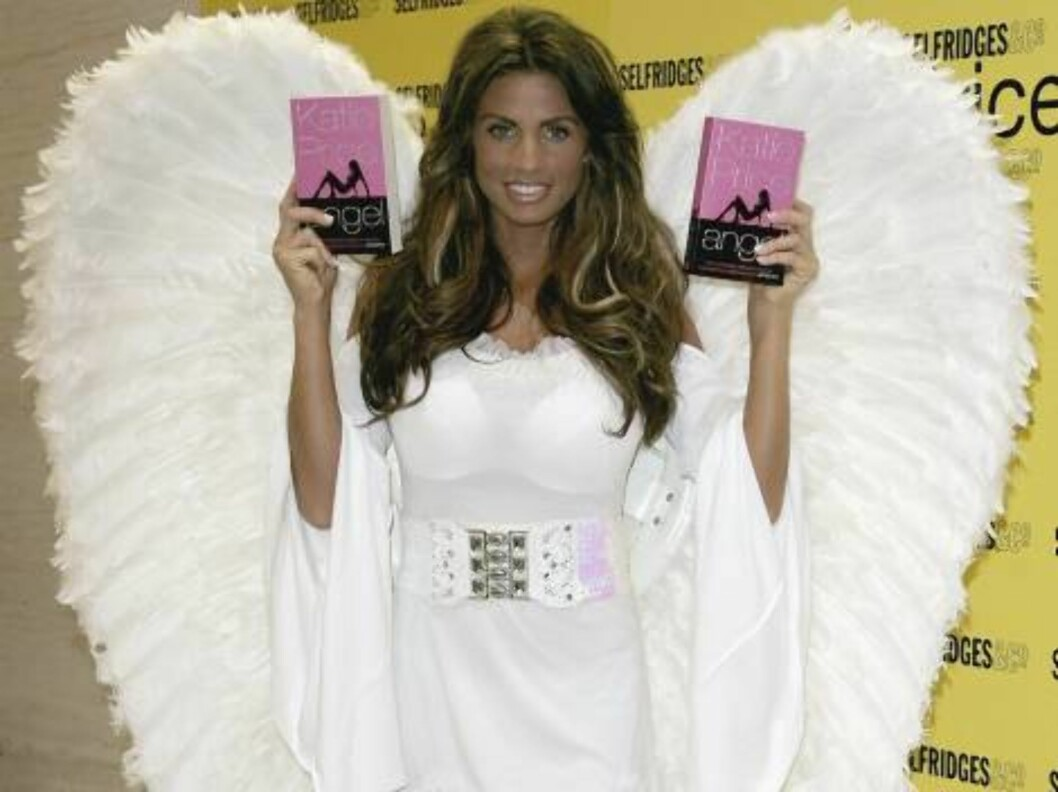 <strong>LONDON - JULY 05:</strong>  Katie Price poses with copies of her book at a book signing of her debut novel 'Angel' At Selfridges on July 5, 2006 in London.  (Photo by Gareth Cattermole/Getty Images) *** Local Caption *** Katie Price  * SPECIAL INSTRUCTIONS:  * *OB Foto: All Over Press