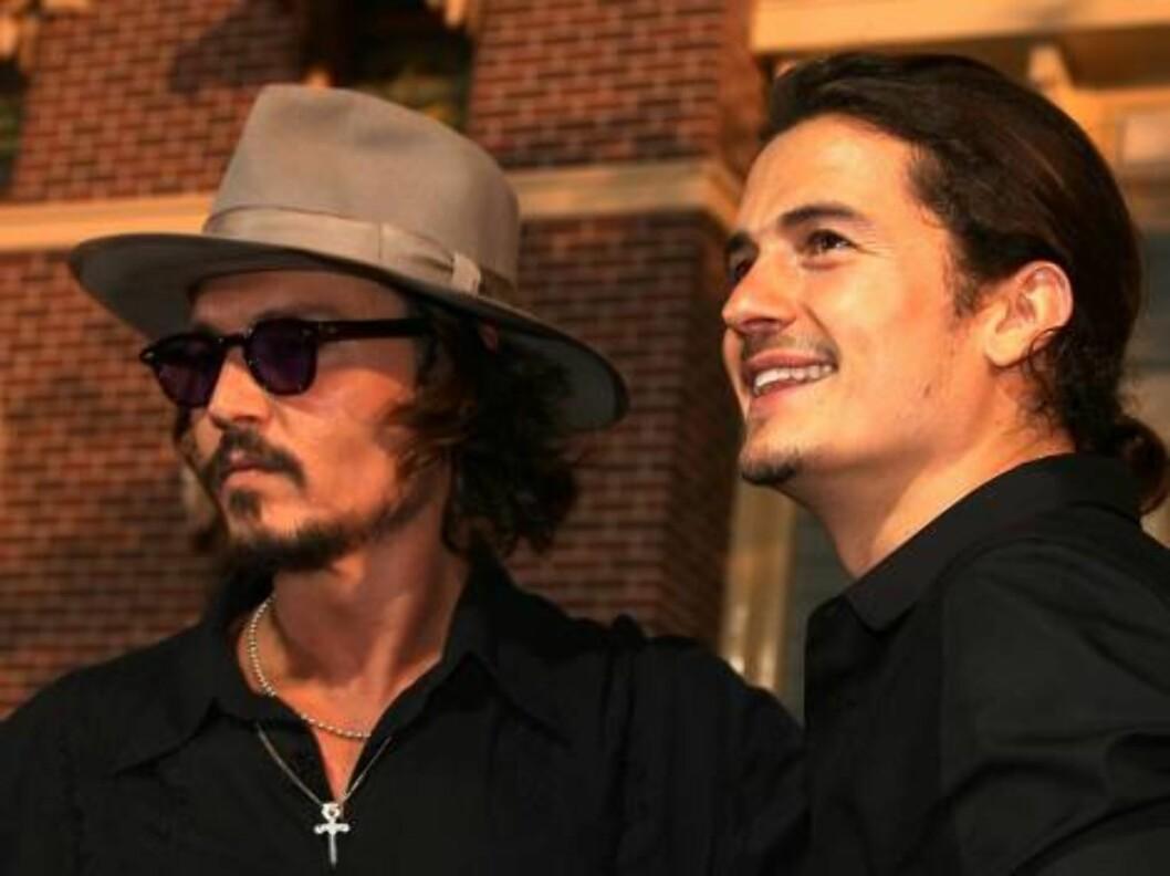 <strong>RØVERE:</strong> Skuspillerne Johnny Depp og Orlando Bloom. Foto: All Over Press