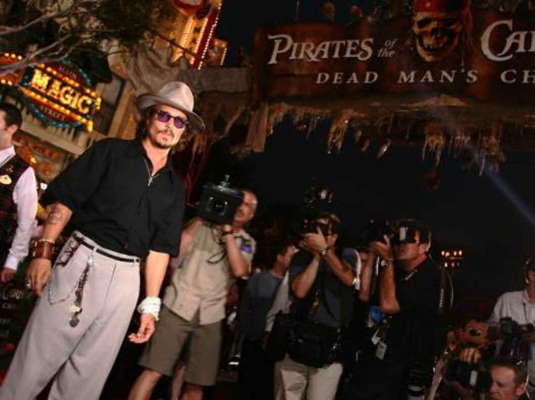 <strong>EKSENTRISK:</strong> Hovedrolleinnehaver Johnny Depp foran pressekorpset. Foto: All Over Press
