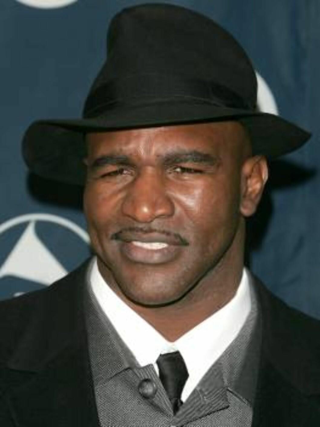 <strong>VANT BEGGE GANGENE:</strong> Evander Holyfield vant i 1997 begge kampene mot Tyson. Foto: All Over Press