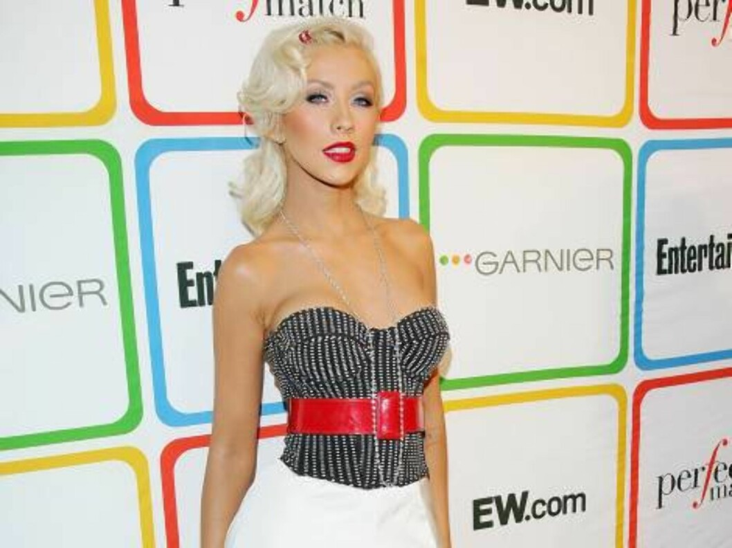 "<strong>NEW YORK - JUNE 22:</strong>  Singer Christina Aguilera arrives at Entertainment Weekly's ""Must List"" party at Buddha Bar June 22, 2006 in New York City.  (Photo by Evan Agostini/Getty Images) *** Local Caption *** Christina Aguilera  * SPECIAL INSTRUCTIONS:  * *O Foto: All Over Press"