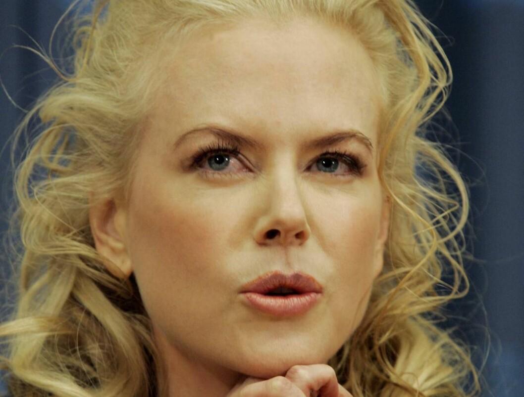NATTENS DRONNING: Kidman ønsker å unngå fotografenes telelinser for enhver pris. Foto: Scanpix/AP