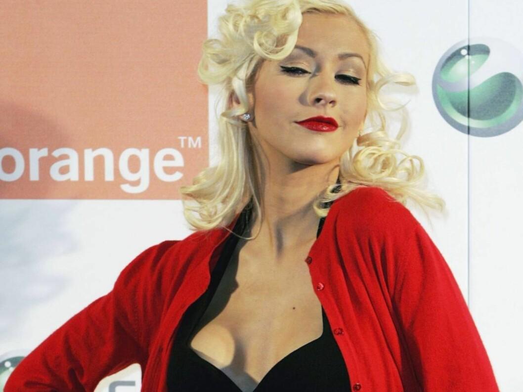 STOLT AV KROPPEN: Christina Aguilera er ikke sjenert. I GQ kaster hun alle klærne. Foto: All Over Press