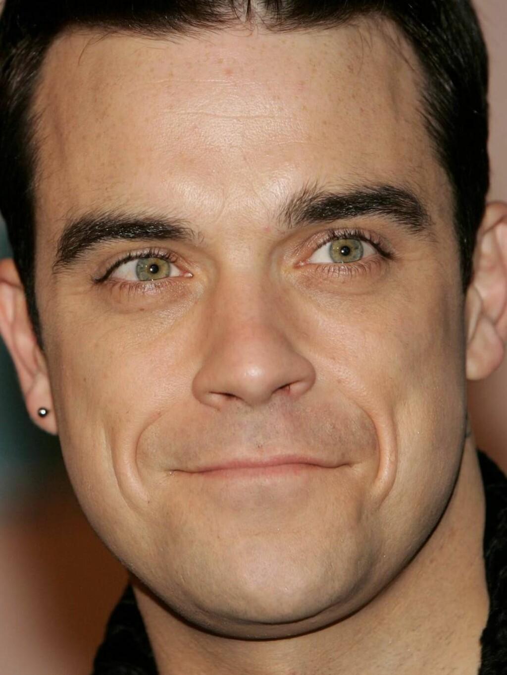 FLØRTEPUS: Britiske kvinner har kåret Robbie Williams til vår tids Casanova. Foto: All Over Press