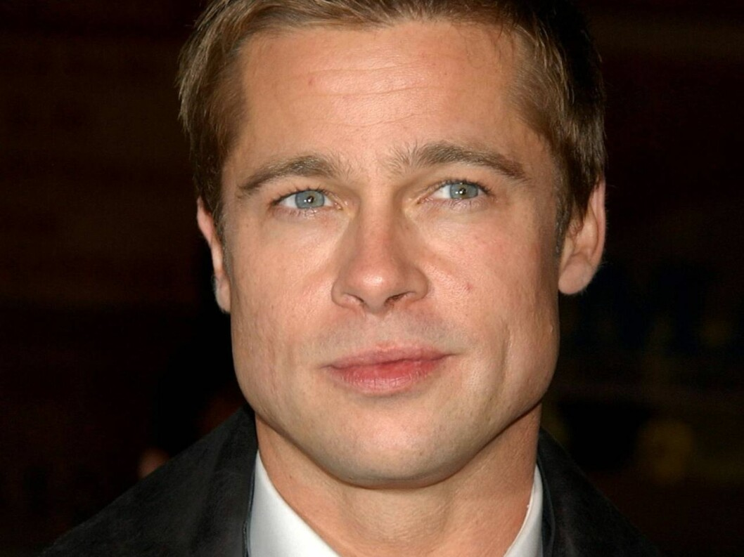"** FILE ** Brad Pitt arrives at the premiere of ""Ocean's Twelve"" in a Los Angeles file photo from Dec. 8, 2004. Pitt is taking on poverty and AIDS in Africa, and the tabloids. In an hour-long ABC ""Primetime Live"" special set to air Tuesday night (10 p.m. Foto: Scanpix/AP"