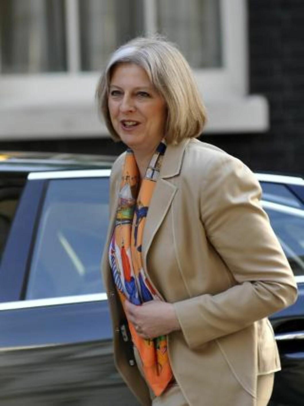 <strong> NYE TAKTER:</strong>  Innenriksminister Theresa May fortalte i dag at den nye regjeringen vil bruke intet mindre enn hundre dager på å skrinlegge den planlagte britiske idenitetsdatabasen. Foto: Scanpix/ Andy Rain