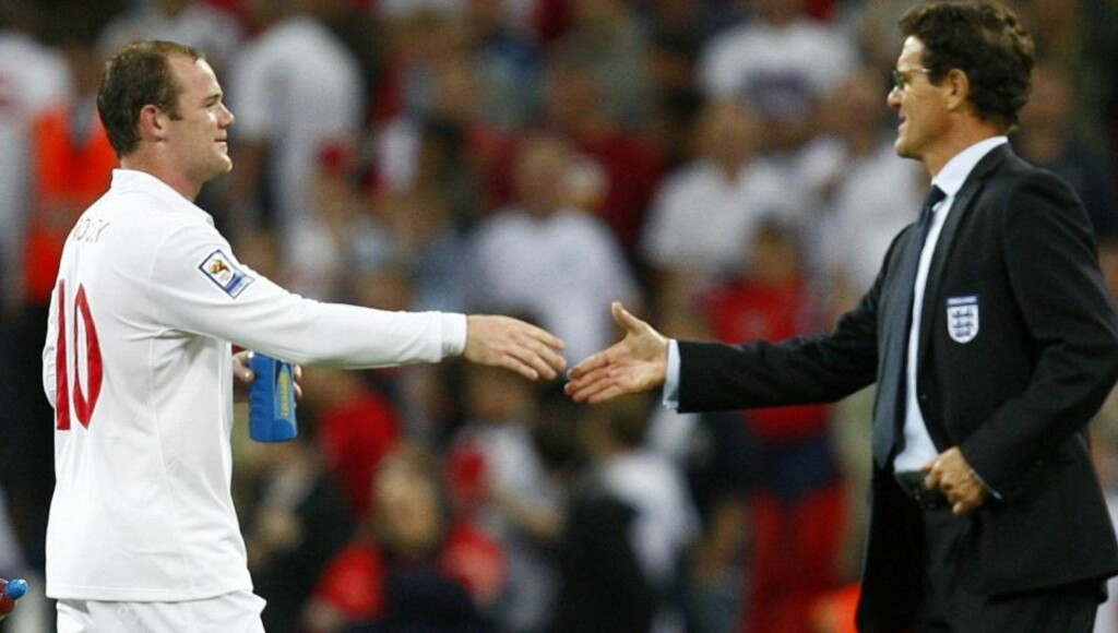 England's manager Fabio Capello (R) shakes hands with Wayne Rooney after their World Cup 2010 qualifying soccer match against Croatia at Wembley Stadium, in London September 9, 2009.    REUTERS/Eddie Keogh (BRITAIN SPORT SOCCER)