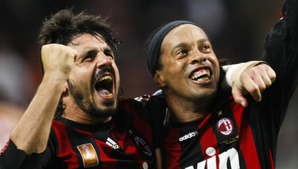 AC Milan Brazilian forward Ronaldinho, right, celebrates with his teammate Gennaro Gattuso after an own-goal scored by Napoli forward German Gustavo Denis of Argentina during an Italian major league soccer match between AC Milan and Napoli at the San Siro stadium in Milan, Italy,  Sunday, Nov. 2, 2008. (AP Photo/Luca Bruno)