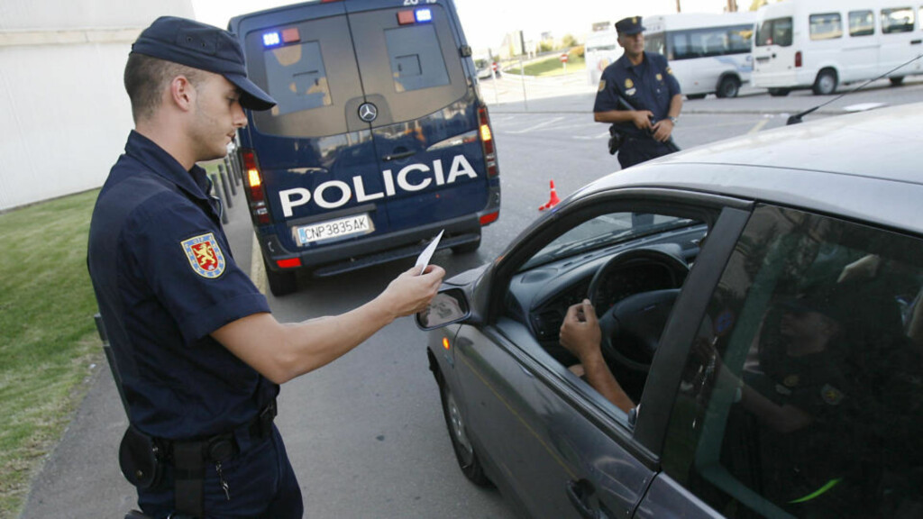 A policeman controls a documents of a driver at a control point at Palma de Mallorca's Airport, on July 31, 2009. Spain went on maximum alert today as ETA marked its 50th anniversary after two bombings this week blamed on the Basque separatist group, including an attack that killed two police officers. AFP PHOTO/ Jaime REINA