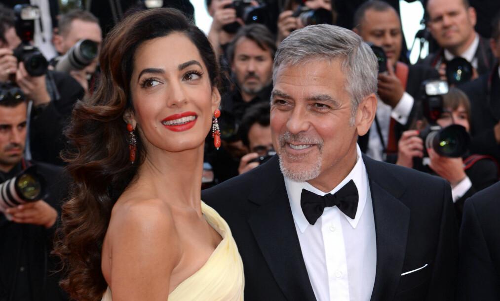 VIL BLI FORELDRE: Ifølge amerikansk kulørt presse forsøker Amal og George Clooney nå å få barn sammen. Her er ekteparet avbildet sammen på rød løper under filmfestivalen i Cannes i mai. Foto: Doug Peters/EMPICS Entertainment/ NTB Scanpix