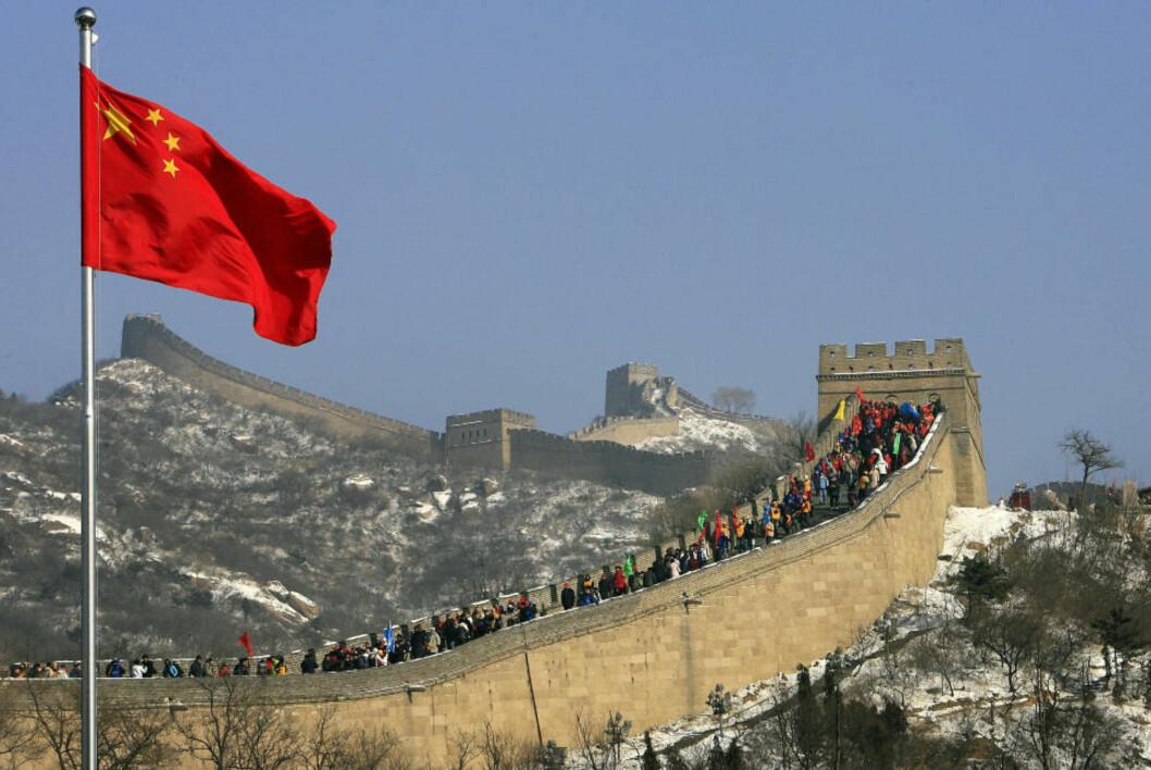 <strong>MYE LENGRE:</strong> Den kinesiske mur kan vise seg å være flere tusen kilometer lengre enn man til nå har trodd. Foto: AFP / FILES / Frederic J. BROWN /SCANPIX