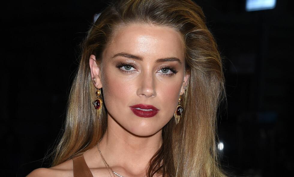 KNUST: Amber Heard og kjæresten Elon Musk gikk tidligere denne måneden hver til sitt. Hun dro direkte til Australia for å bearbeide sorgen. Foto: NTB Scanpix