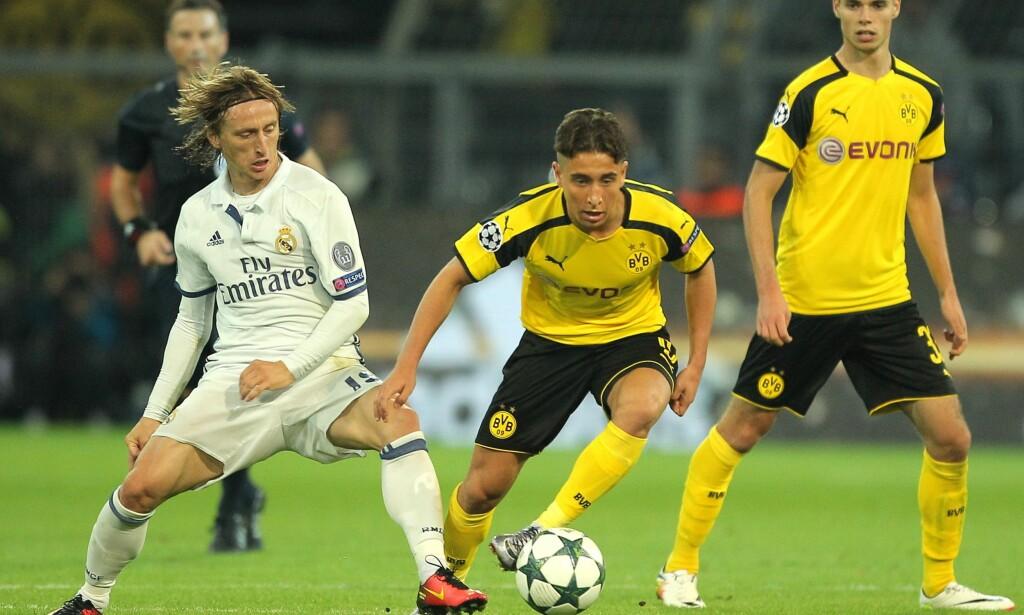 GRUPPEFINALE: Både Real Madrid og Borussia Dortmund er videre, men hvem som vinner gruppa er enda ikke klart. I morgen møtes Luka Modric (til venstre) og Emre Mor til gruppefinale i Madrid. Her fra det omvendte oppgjøret i Tyskland Foto: NTB Scanpix
