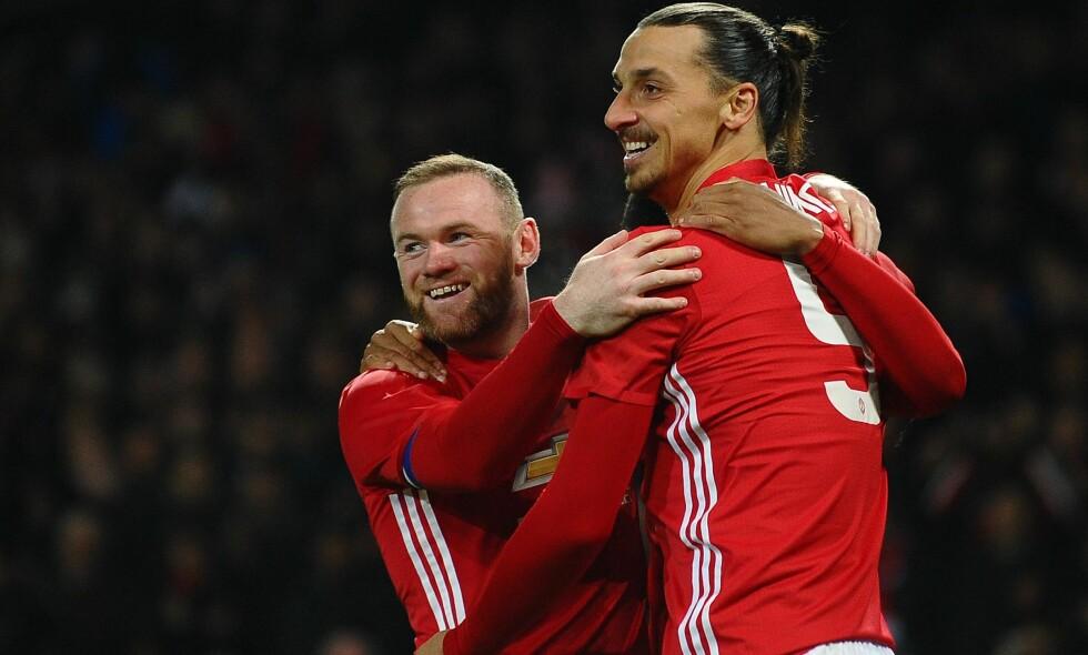 KAN RYKE UT: Manchester United kan risikere å ryke ut av Europa League i kveld. Her feirer Wayne Rooney og Zlatan Ibrahimovic scoring mot West Ham i ligacupkampen 30. november. Foto: NTB Scanpix