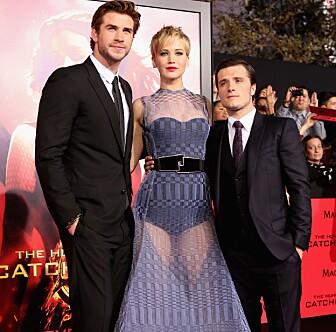 FILMSTJERNE: Jennifer Lawrence, Liam Hemsworth og Josh Hutcherson på «The Hunger Games: Catching Fire»-premieren i L.A. i 2013. Foto: Christopher Polk/Getty Images/AFP/ NTB Scanpix