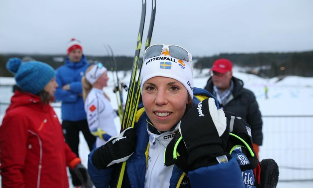 TIL TOPPS: Charlotte Kalla var fornøyd etter at hun vant på Lillehammer i dag. Foto: Geir Olsen / NTB Scanpix