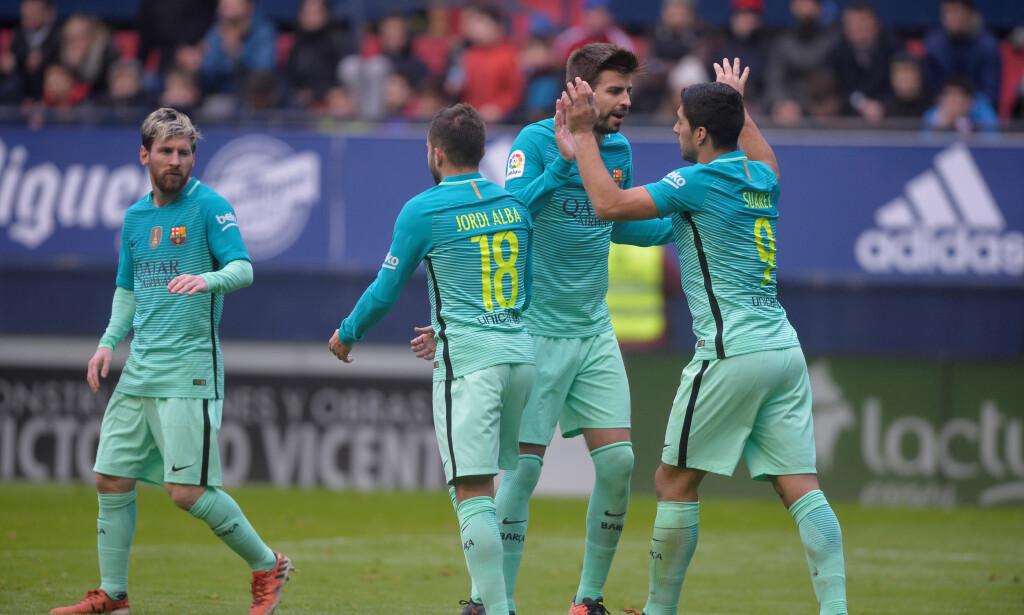 SLIET LENGE: Barcelona stanget lenge mot Osasuna, men vant til slutt 3-0 i lørdagens seriekamp takket være scoringer av Lionel Messi og Luis Suárez. Foto: REUTERS/Vincent West/NTB Scanpix